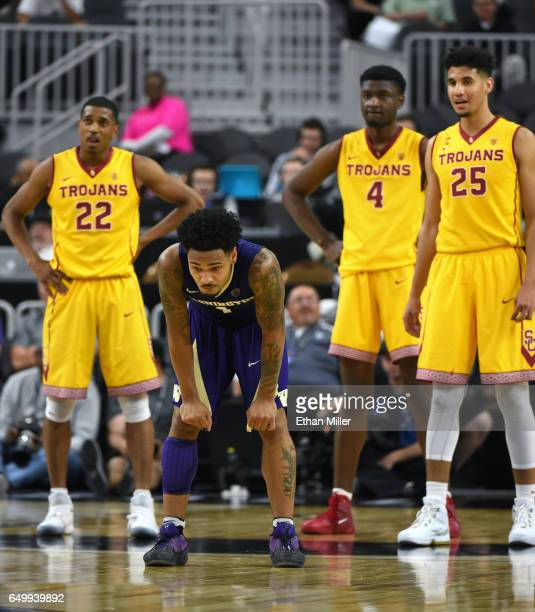 De'Anthony Melton Chimezie Metu and Bennie Boatwright of the USC Trojans look on as David Crisp of the Washington Huskies reacts after missing a...