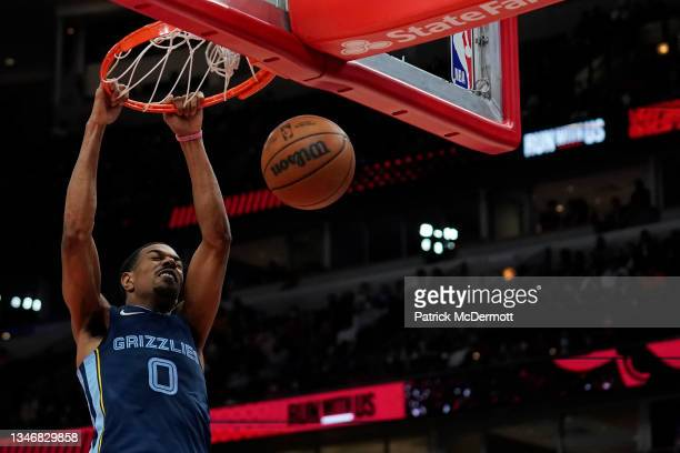 De'Anthony Melton of the Memphis Grizzlies makes a dunk against the Chicago Bulls in the second half during a preseason game at United Center on...