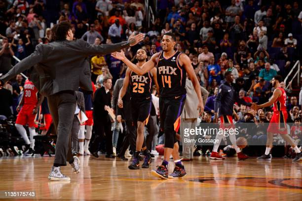De'Anthony Melton of the Phoenix Suns and Kelly Oubre Jr #3 of the Phoenix Suns celebrate during the game against the New Orleans Pelicans on April 5...