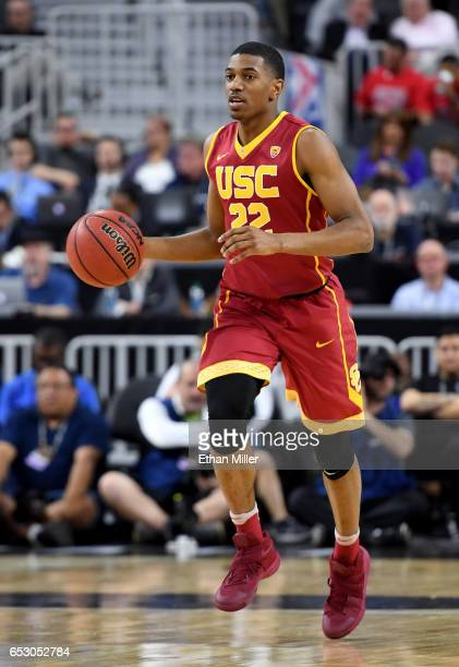 De'Anthony Melton of the USC Trojans brings the ball up the court against the UCLA Bruins during a quarterfinal game of the Pac12 Basketball...