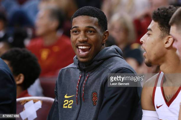 De'Anthony Melton of the USC Trojans cheers on his team from the bench against the Texas AM Aggies during a college basketball game at Galen Center...