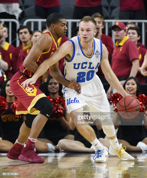 De'Anthony Melton of the USC Trojans guards Bryce Alford of the UCLA Bruins during a quarterfinal game of the Pac12 Basketball Tournament at TMobile...