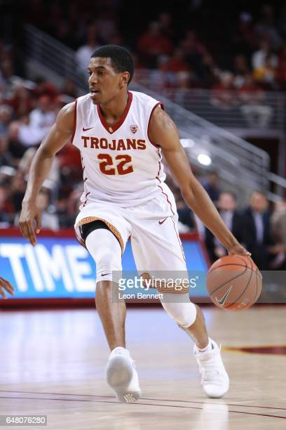 De'Anthony Melton of the USC Trojans handles the ball against the Washington Huskies during a Pac12 conference college basketball game at Galen...