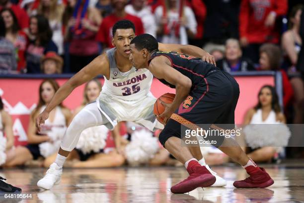 De'Anthony Melton of the USC Trojans is defended by Allonzo Trier of the Arizona Wildcats during the second half of the college basketball game at...