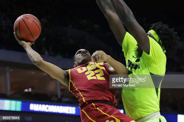 De'Anthony Melton of the USC Trojans is defended by Johnathan Motley of the Baylor Bears during the second round of the 2017 NCAA Men's Basketball...