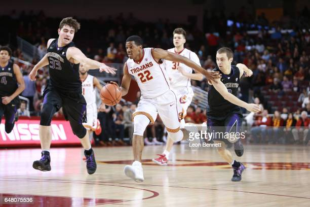 De'Anthony Melton of the USC Trojans pushes the ball up the court against Dan Kingma of the Washington Huskies during a Pac12 conference college...
