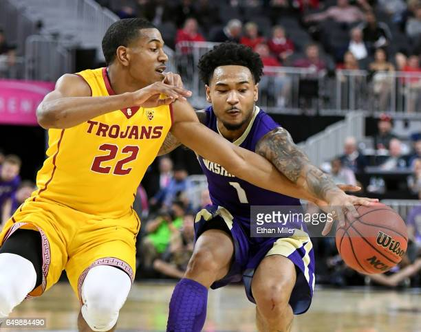 De'Anthony Melton of the USC Trojans tries to steal the ball from David Crisp of the Washington Huskies during a firstround game of the Pac12...