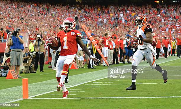 De'Anthony Thomas of the Kansas City Chiefs returns the ball for a touchdown against RJ Stanford of the Cincinnati Bengals at Arrowhead Stadium on...