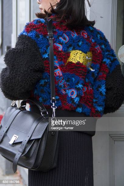 Dear Pichamon is seen at Spring Studios outside the Phillip Lim show wearing faux fur blue and red bomber jacket with black sleeves and embroidered...