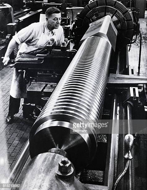 1/22/1951 Dearborn MI Just A Big Thread Jewellike lights and shadows are reflected from the surface of a giant screw undergoing a threadrolling...