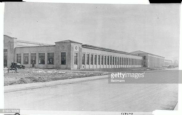 Dearborn, Michigan: Outside view of Ford's new experimental station at Dearborn is shown. Floors of the building are hard maple, and waxed like a...