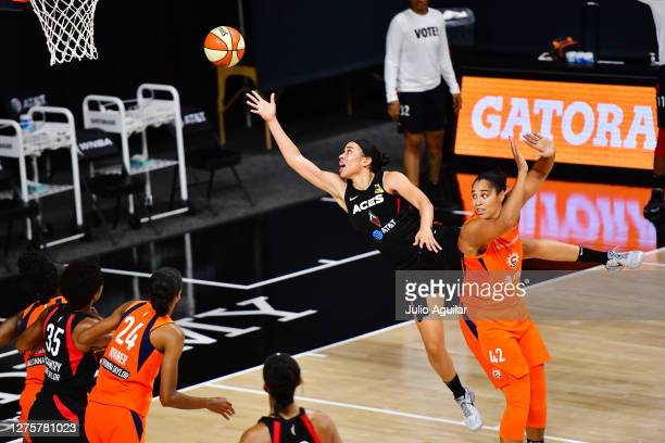 Dearica Hamby of the Las Vegas Aces shoots the ball past Brionna Jones of the Connecticut Sun during the second half of Game 2 of their Third Round...