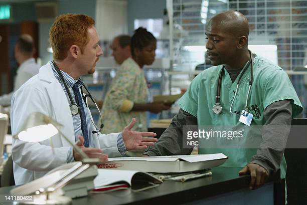 ER 'Death and Taxes' Episode 7 Air Date Pictured Scott Grimes as Doctor Archie Morris Mekhi Phifer as Doctor Gregory Pratt Photo by Byron Cohen/NBCU...