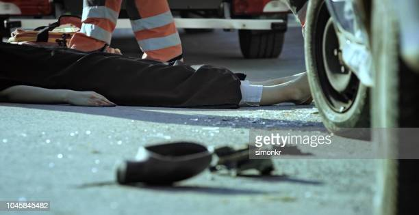 death body covered with black sheet - dead bodies in car accident photos stock photos and pictures