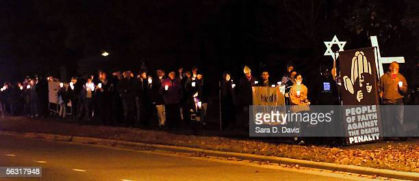 Death penalty opponents hold a candlelight march to the Central Prison December 1 2005 in Raleigh North Carolina Kenneth Lee Boyd convicted of...