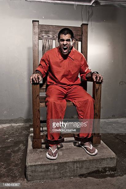 death row inmate in electric chair - electric chair stock photos and pictures