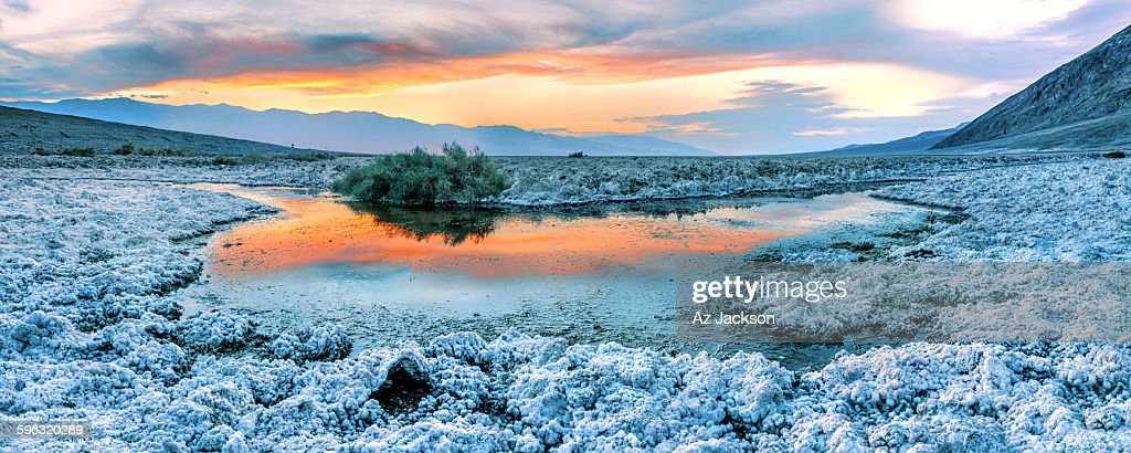 Sunset over a small pond among the salt flats in Badwater country, Death Valley, Nevada.