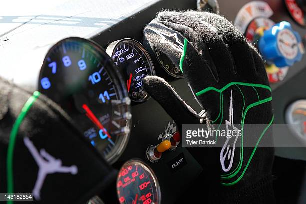 A deatil of gloves on the dashboard worn by Denny Hamlin driver of the FedEx Ground Toyota before the start of practice for the NASACAR Sprint Cup...