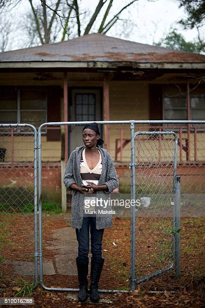 Deatrice Young who is currently unemployed and supports Hillary Clinton as a presidential candidate poses for a photo outside her house February 22,...