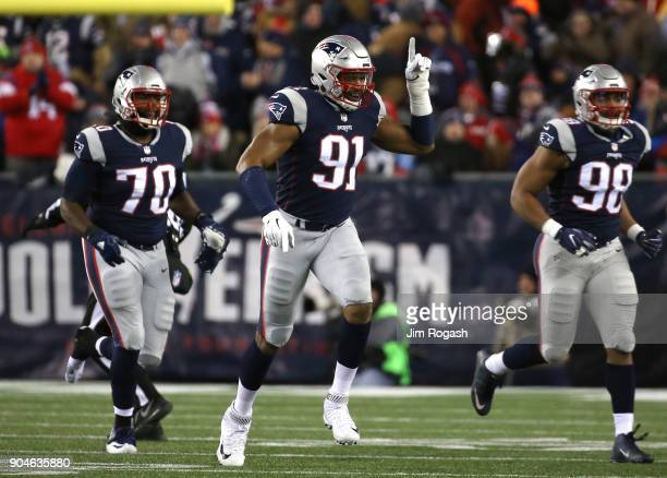 Deatrich Wise Jr #91 of the New England Patriots celebrates a sackalongside Adam Butler and Trey Flowers in the first quarter of the AFC Divisional...