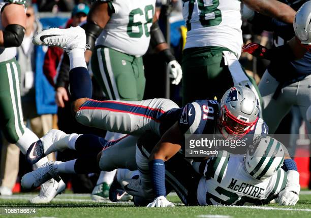 Deatrich Wise Jr #91 of the New England Patriots tackles Elijah McGuire of the New York Jets during the first quarter of a game at Gillette Stadium...