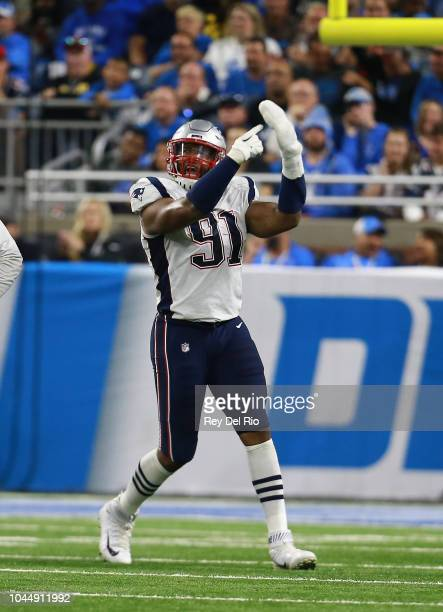 e58da8cbdeb Deatrich Wise of the New England Patriots celebrates his tackle during the  game against the Detroit