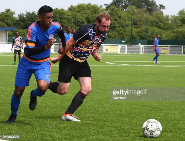 LR Deaueyean Soprayen of Chagos Islands and Buseni Sibindi of Matabeleland during Conifa Paddy Power World Football Cup 2018 Friendly between...