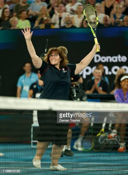 Deb a firefighter acknowledges the crowd after playing on court during the Rally for Relief Bushfire Appeal event at Rod Laver Arena on January 15...
