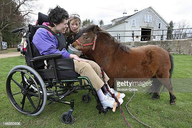 Deb Berglund a disabled adult and Alice McKissick of RRI feed a miniature horse At Elm Hill Farm in Brookfield disabled adults help to feed the...