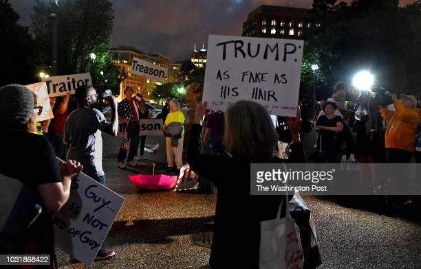 Deb Dady carries a sign that says 'Trump As fake as his hair' She traveled from from Rhode Island to take part in the protest AntiTrump protestors...