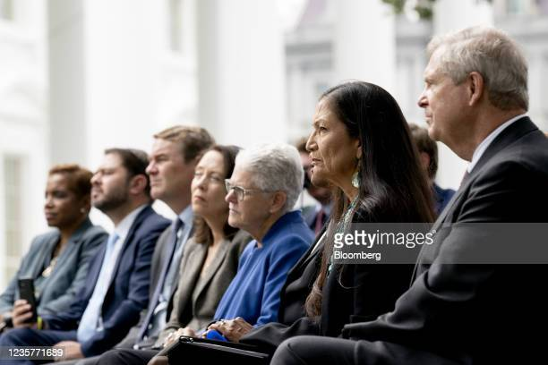 Deb Haaland, U.S. Secretary of the interior, second right, listens as U.S. President Joe Biden, not pictured, speaks on the North Lawn of the White...