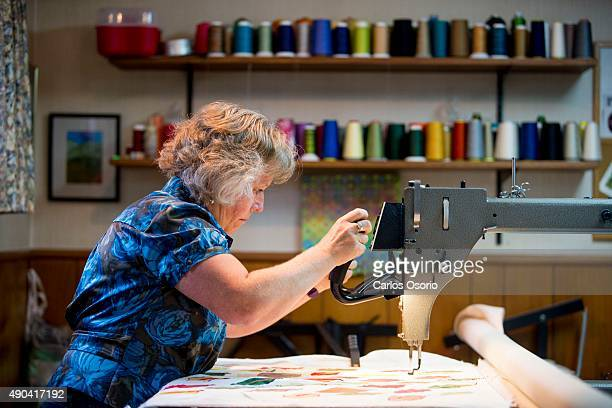 TORONTO ON AUGUST 24 Deb Kopeschny working on an art quilt about leaves in which the background will be filled in with tangle patterns at her home in...