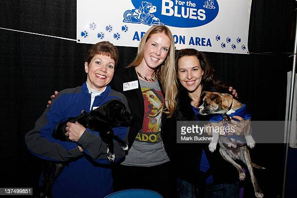 Deb Saulich Kelly Backes and Petra Halak pose for a photo during Barkin' for the Blues a pet adoption event spearheaded Kelly Backes wife of David...