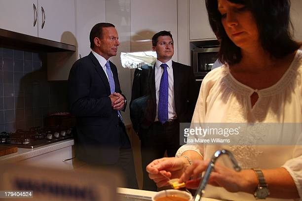 Deb Schmusch makes a coffee for Australian Opposition Leader Tony Abbott at her home on September 3 2013 in Adelaide Australia In the 2010 election...