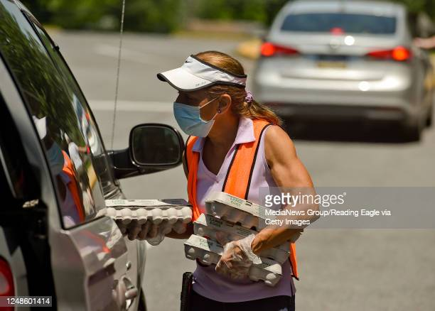 Deb White gives out cartons of eggs. At the Brandywine Heights Intermediate and Middle School in Topton Tuesday afternoon June 9, 2020 where Helping...