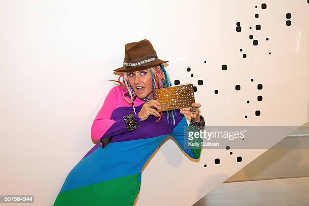 Deb Windham poses with the Scintillator clutch at Barneys New York on January 29 2016 in San Francisco California
