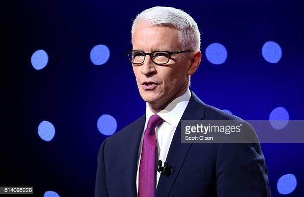 Debate moderator Anderson Cooper looks during the CNN Democratic Presidential Primary Debate between Democratic presidential candidate Hillary...