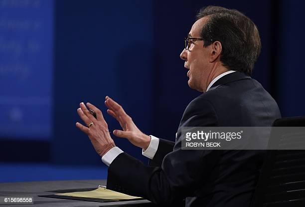 Debate moderator Chris Wallace speaks during the final US presidential debate between Democratic nominee Hillary Clinton and Republican nominee...