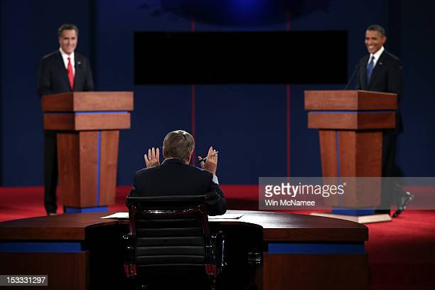 Debate moderator Jim Lehrer speaks to Democratic presidential candidate US President Barack Obama and Republican presidential candidate former...