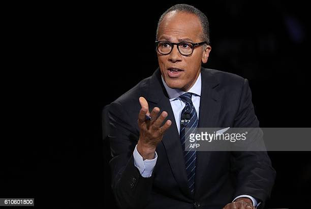 Debate moderator Lester Holt talks during the first presidential debate at Hofstra University in Hempstead New York on September 26 2016 Hillary...