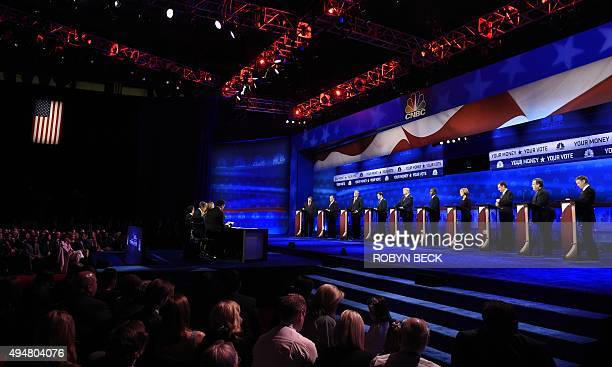 Debate moderators at left John Harwood Becky Quick and Carl Quintanilla question candidates at the third Republican Presidential Debate hosted by...