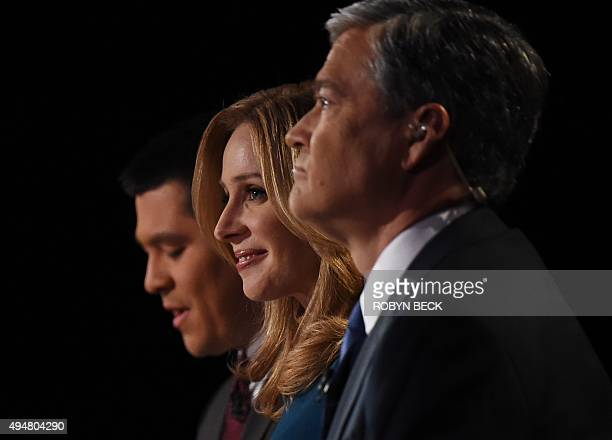Debate moderators Carl Quintanilla Becky Quick and John Harwood question candidates at the third Republican Presidential Debate hosted by CNBC...