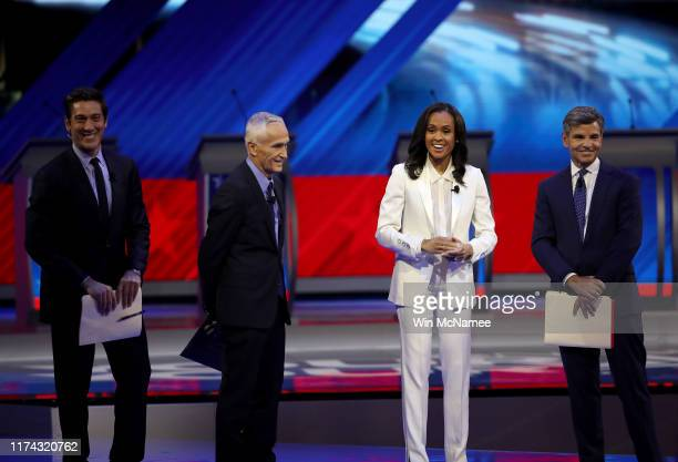 Debate moderators David Muir of ABC News, Jorge Ramos of Univision, Linsey Davis of ABC News, and George Stephanopoulos of ABC News appear on stage...