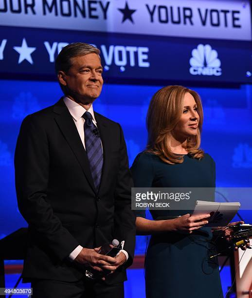 Debate moderators John Harwood and Becky Quick take the stage at the third Republican Presidential Debate hosted by CNBC October 28 2015 at the Coors...