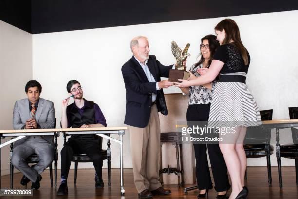 Debate team receiving award on stage