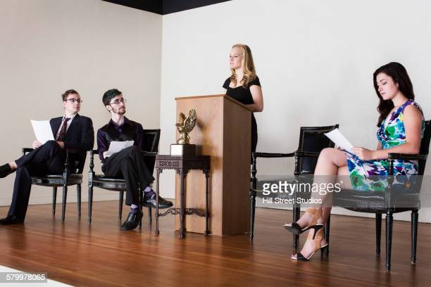 debate team speaking on stage - american influenced awards stock pictures, royalty-free photos & images
