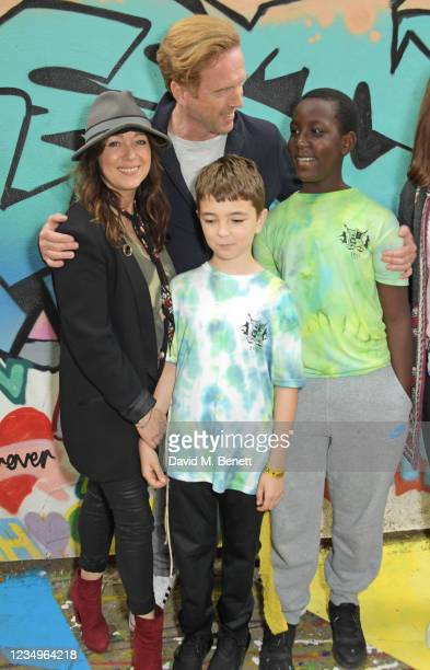 Debbi Clark and Damian Lewis pose with cast members Riley De-Gragg and Joshua Bamgbose at a performance of the Sir Hubert Von Herkomer Arts...