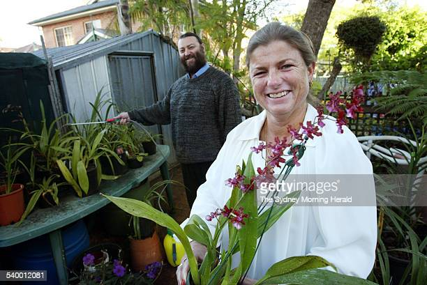 Debbi Wares and her husband Garry in their garden have been growing orchids for years 30 May 2006 SMH Picture by NARELLE AUTIO