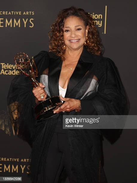 """Debbie Allen poses with the award for Outstanding Choreography for Scripted Programming for """"Dolly Parton's Christmas on the Square"""" at the Creative..."""