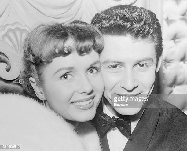 Debbie and Daddy...Actress Debbie Reynolds, shown above with her husband, singer Eddie Fisher, gave birth to a six-pound, 12-ounce baby girl here...